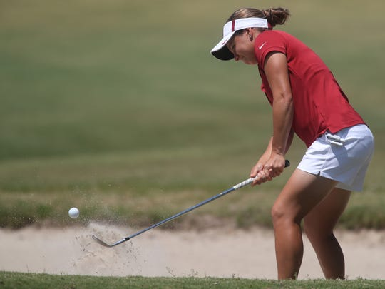 FSU's Amanda Doherty chips from a bunker during the