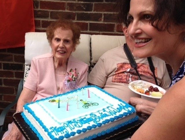 Cathy Washabaugh Presents The Birthday Cake To Her 90 Year Old Mother Sheila