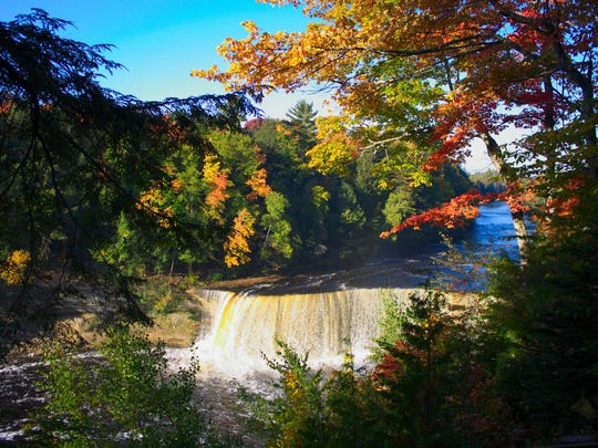 The trees around Tahquamenon Falls make waterfall viewing an extra special sight in the fall