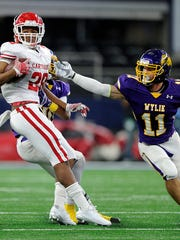 Wylie safety Cameron Hanna (11) chases down Carthage running back Keaontay Ingram (28) during the first quarter of Wylie's 31-17 loss in the Class 4A Div. I state championship game on Friday, Dec. 16, 2016, at AT&T Stadium in Arlington.