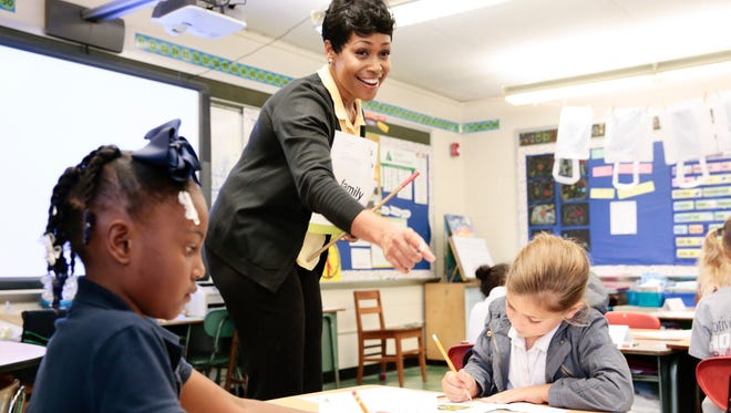 Home Bank's Tonia Davis directs students at Prairie Elementary School during Junior Achievement' of Acadiana's Financial Literacy Day in Lafayette May 4, 2016.
