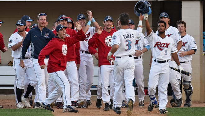 St. Cloud Rox players celebrate a run in the fourth inning during Thursday's game against La Crosse at Joe Faber Field in St. Cloud.