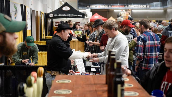 Samples are poured from several breweries Saturday, Jan. 21, during the St. Cloud Craft Beer tour at the River's Edge Convention Center in St. Cloud.