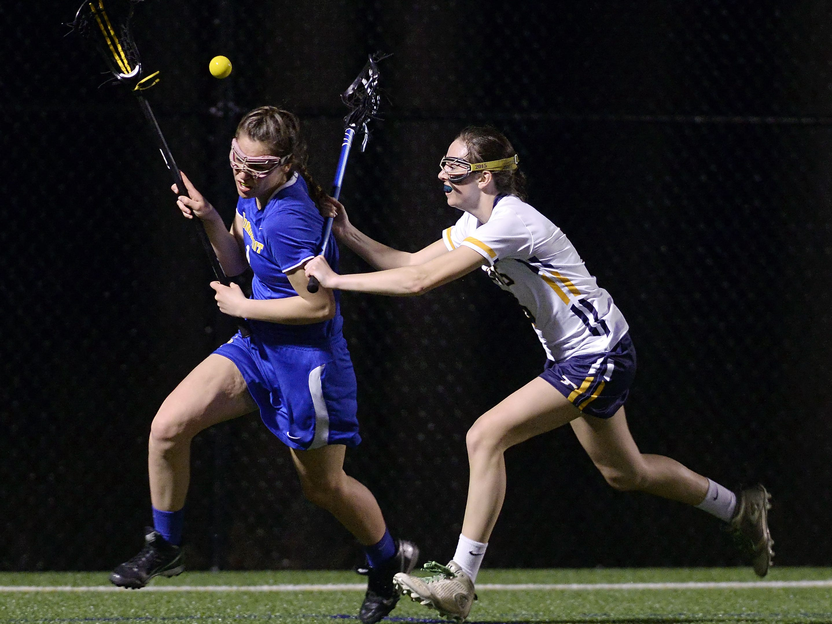 Webster Thomas' Marley Morrill, right, knocks the ball away from Irondequoit's Mary Clare Bowes.