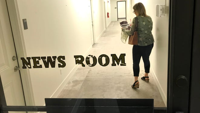 Tina Torres, leasing agent for The Press, walks down a hallway between apartments built where the Journal & Courier newsroom once was. The J&C moved in April 2016. Weinstein Nelson Development, a Baton Rouge, La., company, renovated the property at Sixth and Ferry streets into 54 studio and one-bedroom apartments.