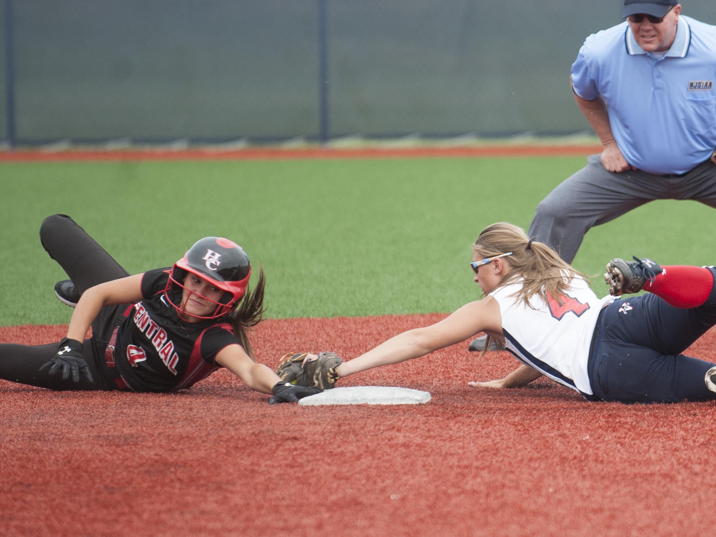 Washington Township's Jessica Hughes, right, tags out Hunterdon Central's Ally Hernandez as Hernandez attempts to steal 2nd base during the state group 4 softball semifinal game between Washington Township and Hunterdon Central played at Eastern High School on Thursday. Washington Township won 10-0. 06.03.15