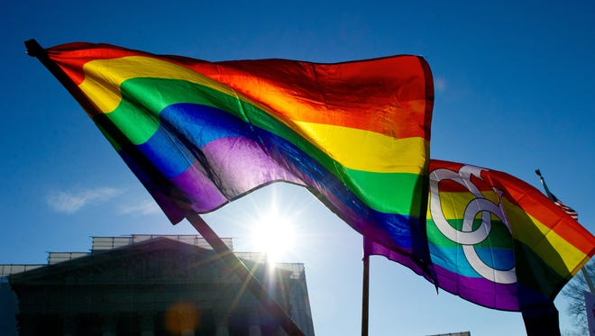 Gay pride flags fly at the Supreme Court in Washington in 2013.