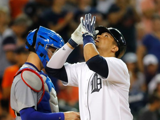 Tigers' Victor Martinez celebrates his solo home run