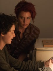 Abbie (Greta Gerwig, center) introduces her landlord's son, Jamie (Lucas Jade Zumann) to punk music and intersectional feminism.