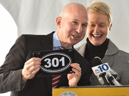 Gov. Jack Markell receives a 301 commemorative license plate from DelDOT Secretary Jennifer Cohan at the groundbreaking of the highway 301 project in Middletown.