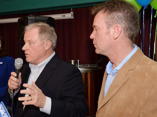 State Sen. Scott Wagner, left, speaks during the victory