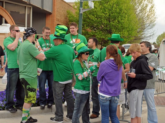 St. Patrick's Day Downtown Street Festival attendees don their green in this file photo.