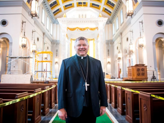 Bishop Richard Stika stands inside the new Cathedral