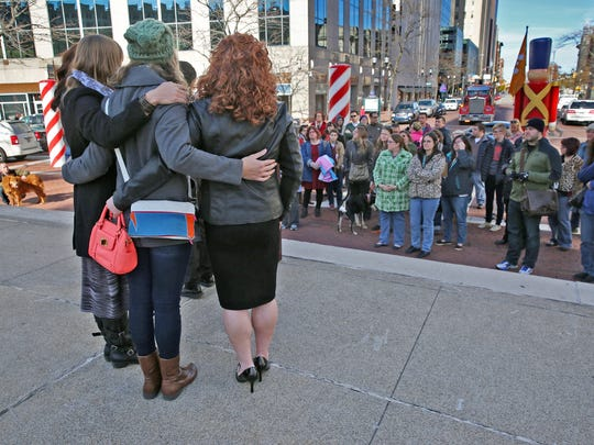 Support is given as names of victims of anti-transgender violence are read during the Transgender Day of Remembrance event, Friday, November 20, 2015. Members of the transgender community were joined by family, friends and supporters on Monument Circle at the remembrance event honoring the memory of those whose lives were lost in acts of anti-transgender violence. The group then walked in silence to the Statehouse.