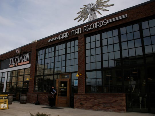 Workers at Third Man Records on Canfield in Detroit