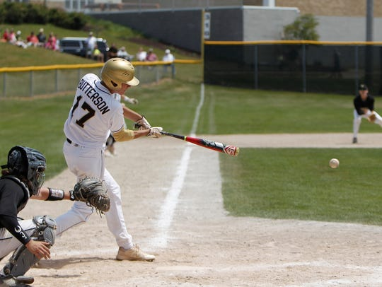Holt senior Robert Butterson hits a line drive for