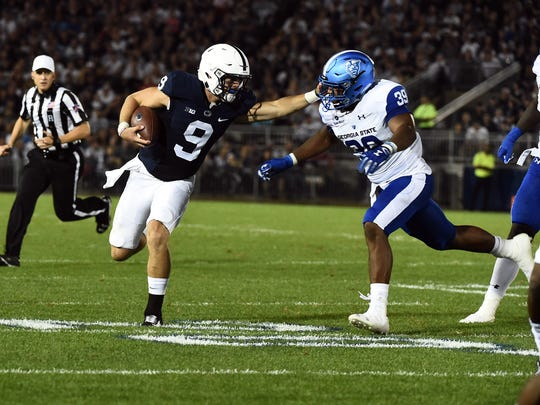 Penn State quarterback Trace McSorely stiff arms Georgia State's Chase Middleton, Saturday, September 16, 2017. The Nittany Lions beat the Panthers, 56-0.