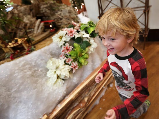 Ike Moonshower, 4, runs non-stop around the Eiteljorg Museum's Jingle Rails: The Great Western Adventure miniature train exhibit, Monday, Nov. 20, 2017.