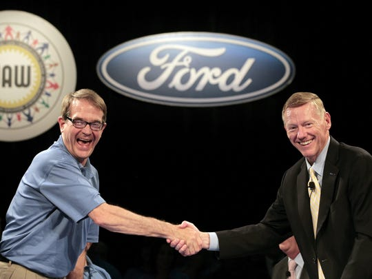 Bob King, president of the UAW, left, shakes hands with Alan Mulally, executive chairman of Ford Motor Co., at the start of labor talks in Dearborn on Friday, July, 29, 2011.