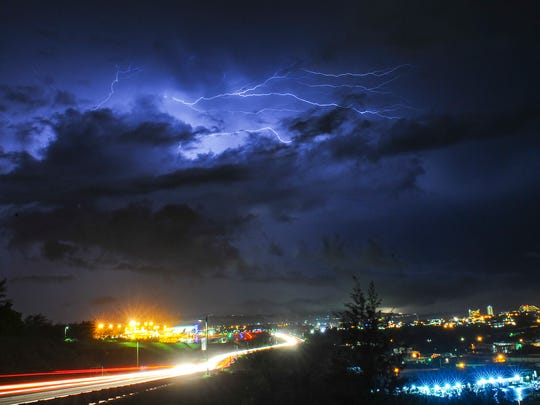 A bolt of lightning branches out across the night sky above the A.B Won Pat International Airport on Monday, Aug. 1.