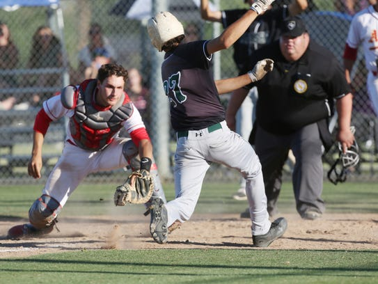 Palm Desert High School's Anthony Boetto applies a