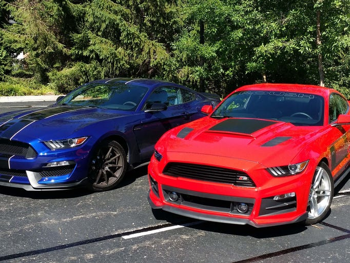 The Shelby GT350, left, and Roush Stage 3 Mustangs