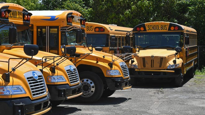 The Erie School District will continue to use its yellow buses to transport nonpublic students in kindergarten through eighth grade, but the School Board favors not providing buses for nonpublic high school students.