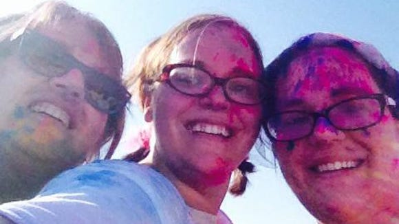Bev Brown with twin daughters Abbey Doyle and Sarah Spurgeon after a color run.