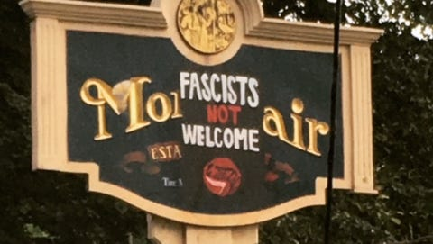 """A Montclair municipal sign on Grove Street, near the Clifton border, is partially covered with an overlay stating """"Fascists not Welcome"""" on Tuesday, Aug. 15."""