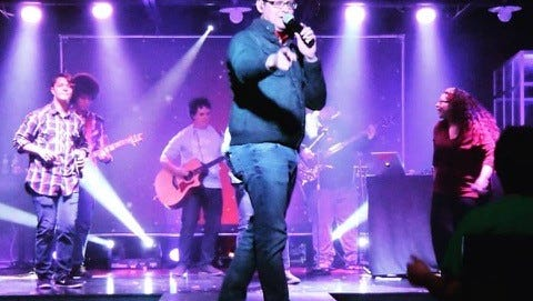 Pastor Jason Shirley performs with his worship band during a performance at Word of Life Church in Carlsbad.