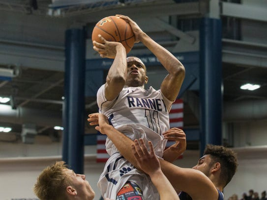 Ranney's Scottie Lewis shoots over the top of Mater