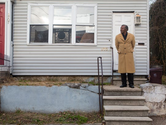 Frank Robinson in front of his home on West 3rd Street in Wilmington.