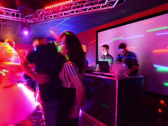 Patrons dance the night away while DJs spin tunes at