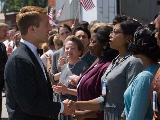 Katherine G. Johnson (Taraji P. Henson), flanked by
