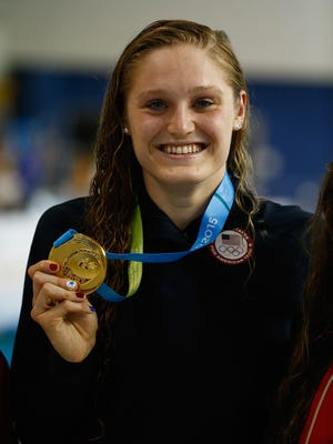 U of L swimmer Kelsi Worrell shows off her gold medal at the Pan American Games in Toronto, Canada. Worrell was part of two records at the Duel in the Pool on Dec. 11, 2015.