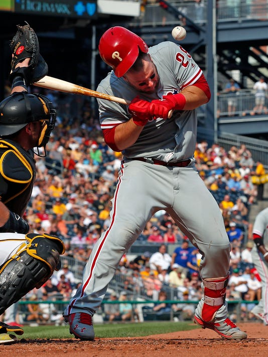 Philadelphia Phillies' Cameron Rupp is hit in the batting helmet by a pitch from Pittsburgh Pirates starting pitcher Tyler Glasnow during the third inning of a baseball game in Pittsburgh, Saturday, July 23, 2016. Rupp left the game. (AP Photo/Gene J. Puskar)