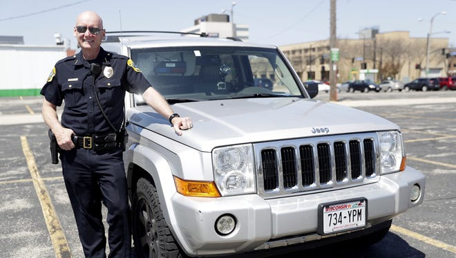 Green Bay Police Chief Andrew Smith poses on May 8, 2018 with the 2007 Jeep Commander he drives regularly. The Jeep was an asset forfeiture vehicle. Sarah Kloepping/USA TODAY NETWORK-Wisconsin