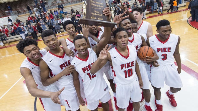 Pike High School players celebrate winning the Marion County Boy's Basketball Tournament championship game, Saturday, Jan. 16, 2016, at Southport High School. Pike won 50-48.