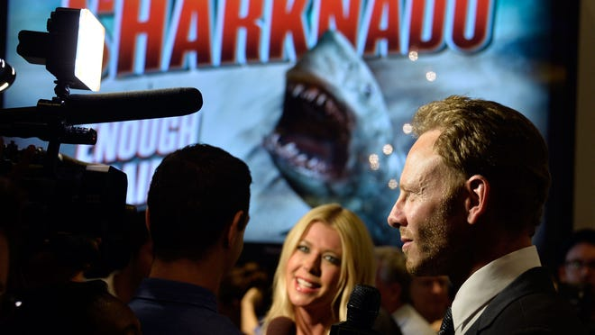 """LOS ANGELES, CA - AUGUST 02:  (L-R)   Actors Tara Reid and Ian Ziering,  at Fathom Events Presents The Premiere Of The Asylum And Syfy's """"Sharknado"""" at Regal Cinemas L.A. Live on August 2, 2013 in Los Angeles, California.  (Photo by Frazer Harrison/Getty Images)"""
