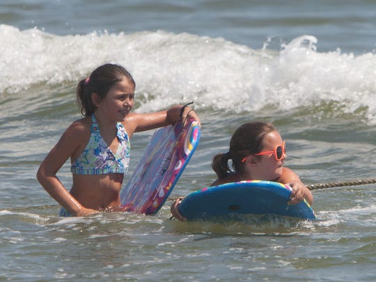 Just like these girls, Jack loves to go boogie boarding in Bradley Beach.