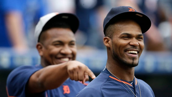 Detroit Tigers relief pitcher Angel Nesbitt, left, points to fellow relief pitcher Al Alburquerque, right, before a baseball game against the Kansas City Royals.