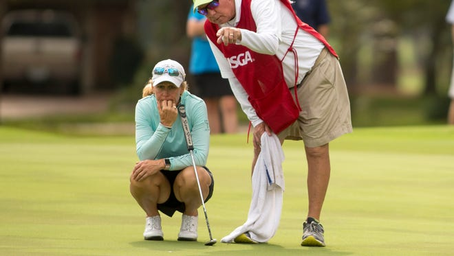 Mary Jane Hiestand listens to her caddie as she prepares to putt on the sixth green during the final round at the 2017 U.S. Women's Mid-Amateur at Champions Golf Club  in Houston, Texas on Thursday, Nov. 16, 2017. (Copyright USGA/Darren Carroll)