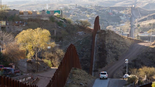 Border Patrol near the border fence along Calle Internacional, in the Buenos Aires neighborhood on the east side of Nogales, Sonora.