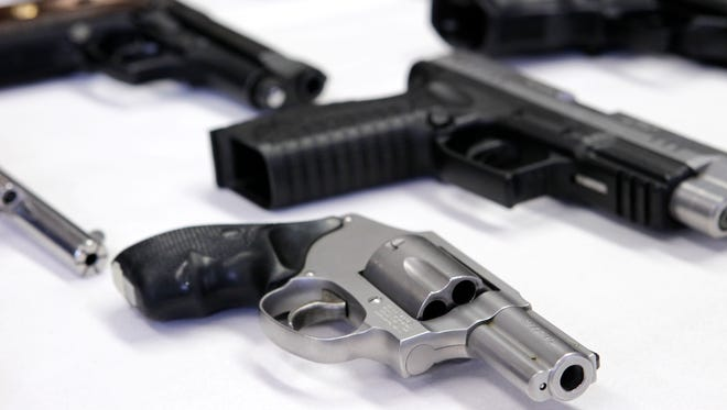 Guns that were purchased by undercover police officers are displayed during a news conference in New York.