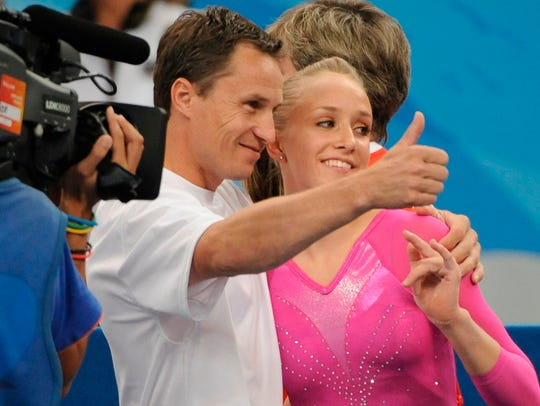 In a file photo from 2008, Valeri Liukin gives the
