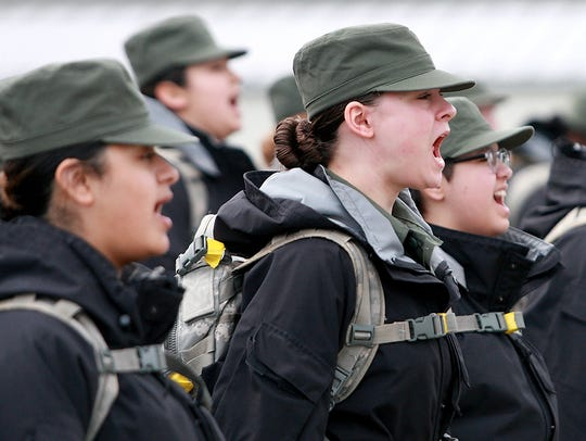 Washington Youth Academy cadets give a yell as they prepare to march to class after lunch on Thursday.