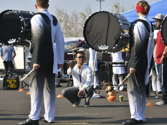 Percussion Instructor Alex Lozada works with Mt. Whitney