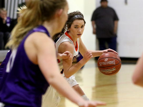 Nocona's Emma Meekins dribbles by Jacksboro defenders