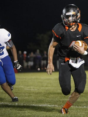 Quarterback Collin Garn gains yardage against Ionia last season. Garn is one of five returning starters on offense for the Orioles.