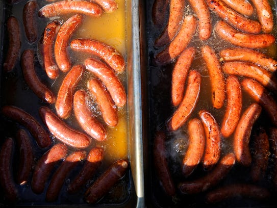 Brats are marinating before they go on the grill at